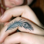 Tiny-Peacock-Feather-Tattoos-on-Finger