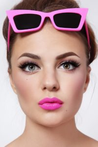 Portrait of young beautiful woman with pink lipstick and stylish